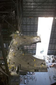 One of the J-level work platforms is powered on and extended in the Vehicle Assembly Building.