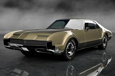 """The very popular Camrao A favorite for car collectors. The Muscle Car History Back in the and the American car manufacturers diversified their automobile lines with high performance vehicles which came to be known as """"Muscle Cars. American Classic Cars, American Muscle Cars, American Auto, Vintage Cars, Antique Cars, Vintage Room, Automobile, Oldsmobile Toronado, Auto Retro"""