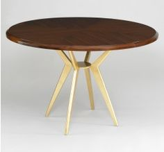 """A gilded base brilliantly offsets the AXEL 48"""" ROUND DINING TABLE's rosewood top. Available from LOFThome.com."""