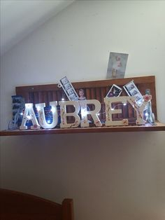 Repurposed shutters for ky grandbeauty's room. Fairy lights, her name and pictures.