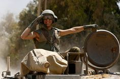 An Israeli soldier salutes as he rides atop a tank near the border with the Gaza Strip August 3, 2014. #IDF