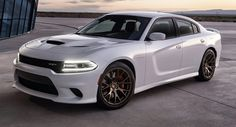 Dodge Charger SRT Hellcat. 707hp. I think I'm in love. It just needs to be all black.