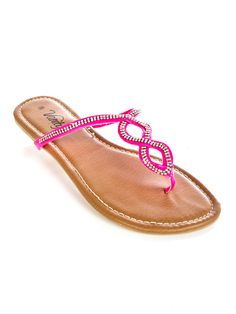 """Strut around in style with these slip on fashion flip flops featuring a twist detail with rhinestones, padded insole and textured outsole. 1/2"""" heel height. Imported. FINAL SALE, NON-RETURNABLE................... evanity.com"""