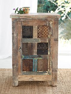 The past is recycled in a cabinet featuring hand-carved panels, each with its own history.