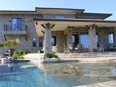 "Flagstone patio slopes into pool for a shallow ""beach"" area...by Don Craighead Homes"