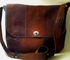 Brown Messenger Bag with green stitching.