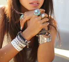 Love the stacked bracelets and chunky rings. You can never wear too much.