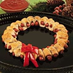Holiday Wreath    Ingredients Mini Sausages Refrigerated Crescent Dough Rolls Red Bell Pepper Diced Rosemary 1/3 cup Butter 1/2 cup BBQ Sauce 1/2 cup Whole Berry Cranberry Sauce