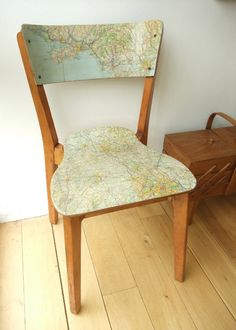 Step one: Find awesome wooden chair. Step two: Find awesome map that I can bare to cut up.