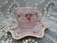 I LOVE this cup and saucer--does anyone know who the maker is/what pattern it is? Kind of looks like Royal Albert, but I've never seen this one before.