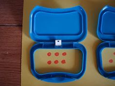 Tops of baby wipe containers used to help students learn their numbers.