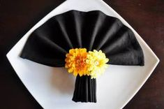 Napkin Origami - Great Napkin Folds for Holiday Tables. This little page on the Pagoda Road web site has photos lots of Asian-inspired ways to fold napkins. Under each photo are links for directions (usually at another site). Neat!
