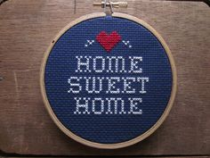 do it yourself x-stitch pattern and materials kit (home sweet home) blue OR red background fabric. $12.00, via Etsy.