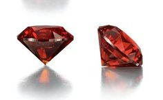An ultra-rare 3.15 ct. red diamond.This circular-cut fancy reddish orange gem is the largest reddish orange diamond ever graded by the Gemological Institute of America, and the largest to appear at auction. - I wonder why they didn't take a pic down through the table ?