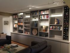 Multi purpose shelving/cupboard unit with inset lighting and bespoke wine racking