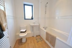 Contemporary white sanitary ware with chrome mixer taps, wall mounted electric thermostatic shower over bath, full height wall tiling and oak effect vinyl flooring Best Places In London, Shower Over Bath, Bathroom Renos, Tiling, Mixer Taps, Finding A House, Vinyl Flooring, Wall Tiles, Home Buying