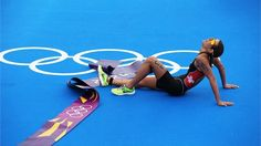 Nicola Spirig of Switzerland lays on the ground after winning the Triathlon. #Olympics Olympics