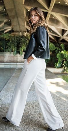 Sleek simplicity meets luxe leather in this modern jacket, which is bonded to a contrasting sheepskin interior to achieve a chic, dual-toned effect. Wear the open-front style to the office or drape it over your shoulders for evening cocktails.