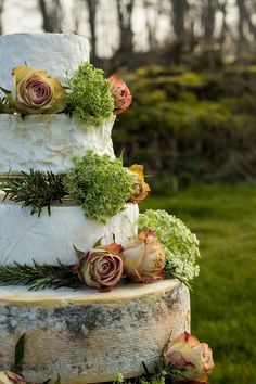 Flowery cheese wedding cake - click on the image to see our full gallery of cool cheese wedding cakes!
