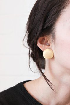 disc earring. each pair will vary slightly due to their handmade and hand cut nature. comes in brass and silver (note, posts are sterling silver while the disc is nickel). brass will age beautifully w