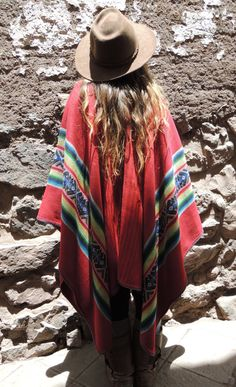 Vintage Alpaca Peruvian Red Poncho with Incan Sun by LivingAltar, $200.00  found in the Sacred Valley of Pisac, Peru    https://www.etsy.com/listing/126500846/vintage-alpaca-peruvian-red-poncho-with?ref=v1_other_2