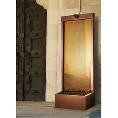 <li>Enhance your surroundings with a stunning waterfall fountain</li> <li>Garden decor features a bronze mirror design</li> <li>Fountain creates a mood of serenity as it humidifies and cleanses the air</li>