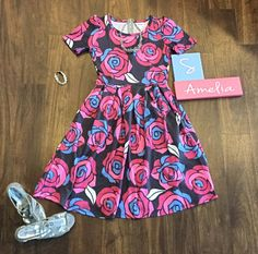 This dress is fit for a princess! So gorgeous! Beautiful LuLaRoe Amelia floral dress. Pink roses! #lularoe #lularoeamelia #boutique #ootd #beautyandthebeast #disney #disneyprincess #womensfashion #onlineboutique #lularoejulieschmieder