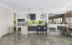 Kitchen and dining room 2 - wall pain - dulux - beige royal half -..stone bench is caeserstone Linen.
