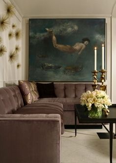 Great Art, U Shaped Sectional, Brass Wall Sculpture. Handsome Room. love the art too.....................s