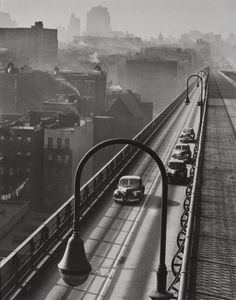 Williamsburg Bridge, 1947, photographed by Harold Roth. Roth received his first camera through a Kodak promotion: the company gave cameras to half a million 12-year-olds in 1930, commemorating the 50th anniversary of George Eastman's first patent. As an adult, Roth became well-known for his shots of New York City street life. http://dlib.nyu.edu/findingaids/html/nyhs/roth_content.html