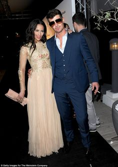 Paula Patton (right) won temporary sole custody of her son on Thursday, after complaining about her ex Robin Thicke's (left) recent disturbing behavior. The couple are pictured above at the 2013 Cannes Film Festival, where Patton claims her then husband hit her