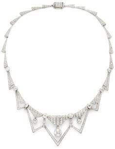 An Art Deco Diamond Necklace, circa, 1930.      An Art Deco diamond necklace, designed as a series of triangular icicle motifs with panel and diamond drop motifs, mounted in platinum. Via 1stdibs.