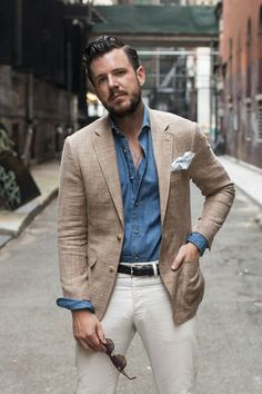 Opt for a camel blazer and white chinos if you're going for a neat, stylish look.   Shop this look on Lookastic: https://lookastic.com/men/looks/blazer-long-sleeve-shirt-chinos/16767   — Blue Chambray Long Sleeve Shirt  — White Pocket Square  — Tan Blazer  — Black Leather Belt  — White Chinos