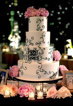 wedding photo by Bob and Dawn Davis Photography, reception, white and black wedding cake detail, pink peonies