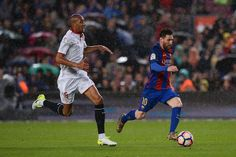 Barcelona's Argentinian forward Lionel Messi (R) runs with the ball followed by Sevilla's French midfielder Steven N'Zonzi during the Spanish league football match FC Barcelona vs Sevilla FC at the Camp Nou stadium in Barcelona on April 5, 2017. / AFP PHOTO / Josep LAGO