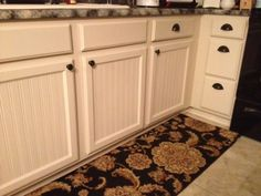 Weathered or Not: Kitchen Cabinet Makeover Tutorial  Uses Beadboard Wallpaper for the redo!