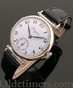 An early 9ct gold round vintage Longines watch, 1924