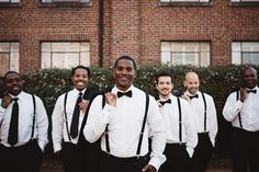 """#Dapperstyle. #Grooms, keeping it classic on your #bigday in black & white is always a #goodlook! We love this look sported by on today's groom, Curtis & his #groomsmen! Head to the blog now to view more from he & #bride Ashley's, """"Industrial Chic"""" wedding captured by @amandasuttonphoto!  #munaluchibride #munaluchi #weddings #grooms #ncweddings #menstyle #bowties #classicmenswear"""