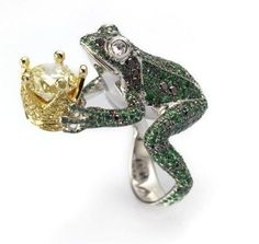 This is a cute idea for a ring, but not on the finger it kind of looks awkard.  LOL  Frog Prince Ring