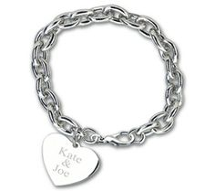 """Silver Heart Link Bracelet Size: 7.5""""L Shower the one you love with a token of your undying affection. Give her our beautiful Silver Heart Link Bracelet and let her know how much you truly care. This stunning silver plated heart tag charm bracelet features a 7.5"""" link and has a lobster clasp closure. The heart charm can be engraved in one of six different font styles to make it a splendidly special gift. Each Silver Heart Link Bracelet comes with a drawstring pouch. The Silver Heart Li"""