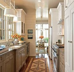 rug, cabinet colors, plank walls, small kitchens, home kitchens, galley kitchens, light, white cabinets, traditional homes