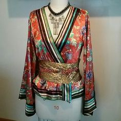 """Floral Wrap Front Kimono Great for a night out, to lounge around the house or a costume idea for Halloween!!! comes with a non detachable embroidered belt with braided ends. Has long bell sleeves. Has a snap and tie closure. Has one pull around back hem and fraying on ends of braided belt. 20"""" bust flat measurement and 24"""" in length. Y Apparel  Jackets & Coats"""