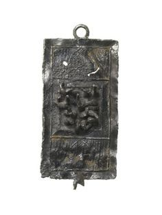Pilgrim badge in the shape of a rectangular carding comb, which is possibly a souvenir from the shrine of St Blaise at Canterbury Cathedral in Kent. St Blaise was martyred in the early 4th century by being torn apart by iron combs and then beheaded. Combs were used as his symbol and he became the patron saint of wool combers. Some of the relics of St Blaise were kept at Canterbury Cathedral in a shrine by the high altar. Production Date: Late Medieval; 14th-15th century