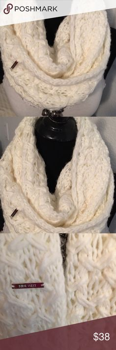 Nine West Infinity Scarf. Gorgeous thick Nine West infinity scarf.  Very  nice knit pattern.  A great accessory for this cold weather. Quite a deal, snatch it before its gone. Nine West Accessories Scarves & Wraps