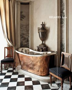 """""""A pair of mahogany Jacob chairs flanks a copper tub in a bathroom."""" Paris apartment decorated by Frederic Mechiche. Photography by Jean-Francois Jaussaud. """"The Gilded Age"""" Elle Decor (January/February Decor, Copper Bathtubs, Copper Tub, Chic Apartment Decor, Apartment Chic, Apartment Decor, Bathroom Design, Bathroom Decor, Beautiful Bathrooms"""
