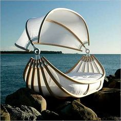 This outdoor lounging bed/chair is great...but throw in the view et voila...MAGIC!!! *sigh*