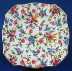 This is a Royal Winton Grimwades, England square side, bread or cake plate in the Old Cottage chintz pattern made in 1995 by Royal Winton in a reissue of one of