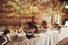 Rustic evening barn wedding feast. Love the lighting and wood.