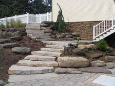 Overlapping and offset block stone steps. I like the low rise and longer tread … – Modern Design - Modern Landscaping With Boulders, Landscaping On A Hill, Outdoor Landscaping, Outdoor Gardens, Landscaping Ideas, Mailbox Landscaping, Landscaping Software, Landscape Steps, Landscape Design