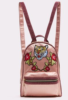 0ffdcfda2a667 Grawn by ALDO. Embellished with tiger head and rose patches